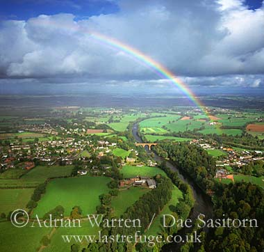 Wetheral village and bridge over the River Eden with rainbow, Cumbria, England