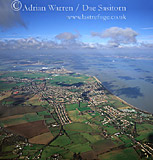 Minster and river Thames estuary, Isle of Sheppey, Kent, England