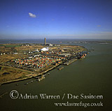 Industrial area, Wallend, Medway River, Isle of Grain, Kent. Container port, Thamesport, Grain power station in background, England