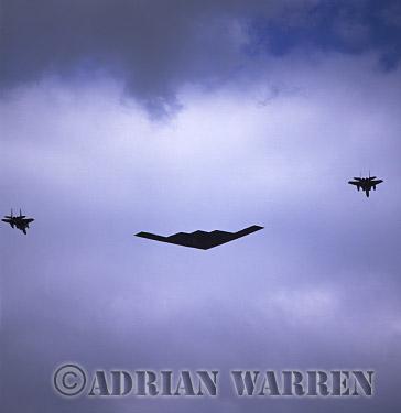 Military Airshow: B-2A Spirit (Stealth Bomber, 325th Bombardment Squadron, United Stated Air Force), accompanied by F15-Eagles, A fly past at The Royal International Air Tattoo 2002, Fairford, Gloucestershire, England, UK