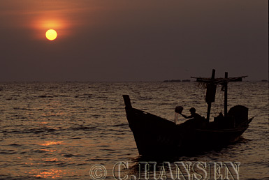 Sunset over Fishing Boat, Nagpali Beach, Myanmar (formerly Burma)