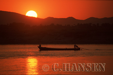 Sunset over Fishing Boat, Ayeyawady River, Mandal, Myanmar (formerly Burma)