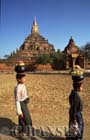 Boys carrying pots on head, with Sulamani Pahto in background, Bagan, Myanmar (formerly Burma)