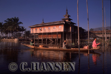 River boat passing Monastery, Inle Lake, Myanmar (formerly Burma)