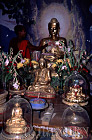 Monk with Buddha Statues,Mingin, Myanmar (formerly Burma)