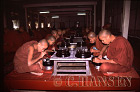 Buddhist Monks having food, Mahagandhayon Kyaung, Mandalay, Myanmar (formerly Burma)