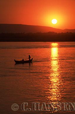 Sunset over Fishing Boat, Ayeyawady River, Mandal, Myanmar (formerly Burma)