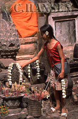 Girl pays respect to Buddha, Wat Phu, Champassak, Ancient Angkor, Laos