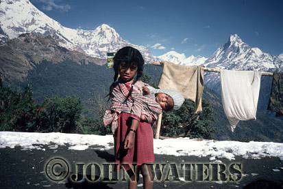 Young girl carrying baby, Tatopani, Nepal, Asia