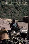 Preparing wool for spinning, near Tatopani, Nepal, Asia