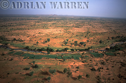 Aerials (aerial image) of Africa : Agriculture by river on plateau area near BANDIAGARA,Mali