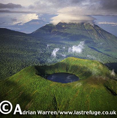 Aerials (aerial image) of Africa: Mount Visoke with Mount Mikeno in background , Virunga Volcanoes, Rwanda, 2003