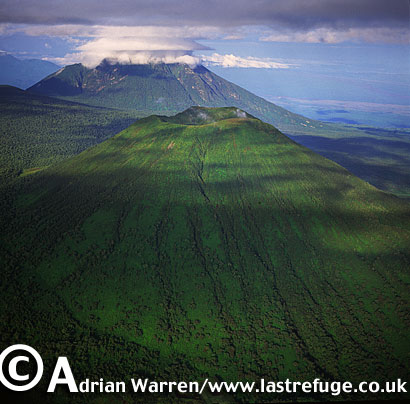 Aerials (aerial image) of Africa: Mount Visoke with Mount Mikeno in background , Virunga Volcanoes, Rwanda, 2003