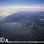 Aerials (aerial image) of Africa: the Parc National des Volcans, home of Mountain Gorilla, 2003
