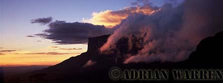 Aerials (aerial photo) of Tepuis, South America: Mount Kukenaam in clouds at sunset (Kukenan, Cuguenan), Venezuela