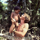 Waorani Indians, a child with Adrian Warren, Rio Cononaco, Ecuador, 1983
