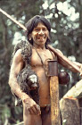 Waorani Indians : Caempaede returning from hunt with Saki Monkey, rio Cononaco, Ecuador, 1983
