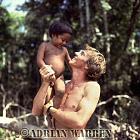 Waorani Indians : Boy with Adrian Warren, rio Cononaco, Ecuador, 1983