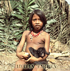 Waorani Indians, Girl with Spider Monkey pet, rio Cononaco, Ecuador, 1983